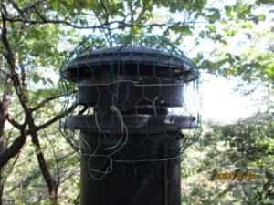 煙突トップに網を付ける
